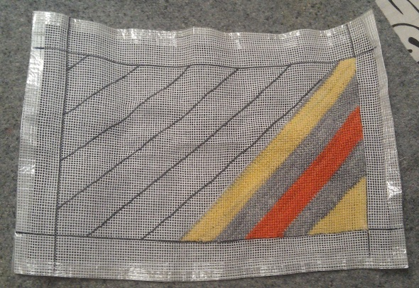Rows of seven stitches with gray and alternating yellow + orange.